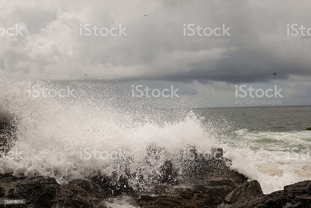Waves crashing on the rocks royalty-free stock photo
