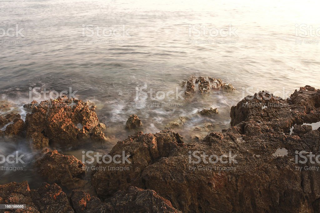 waves crashing on the rocky beach royalty-free stock photo
