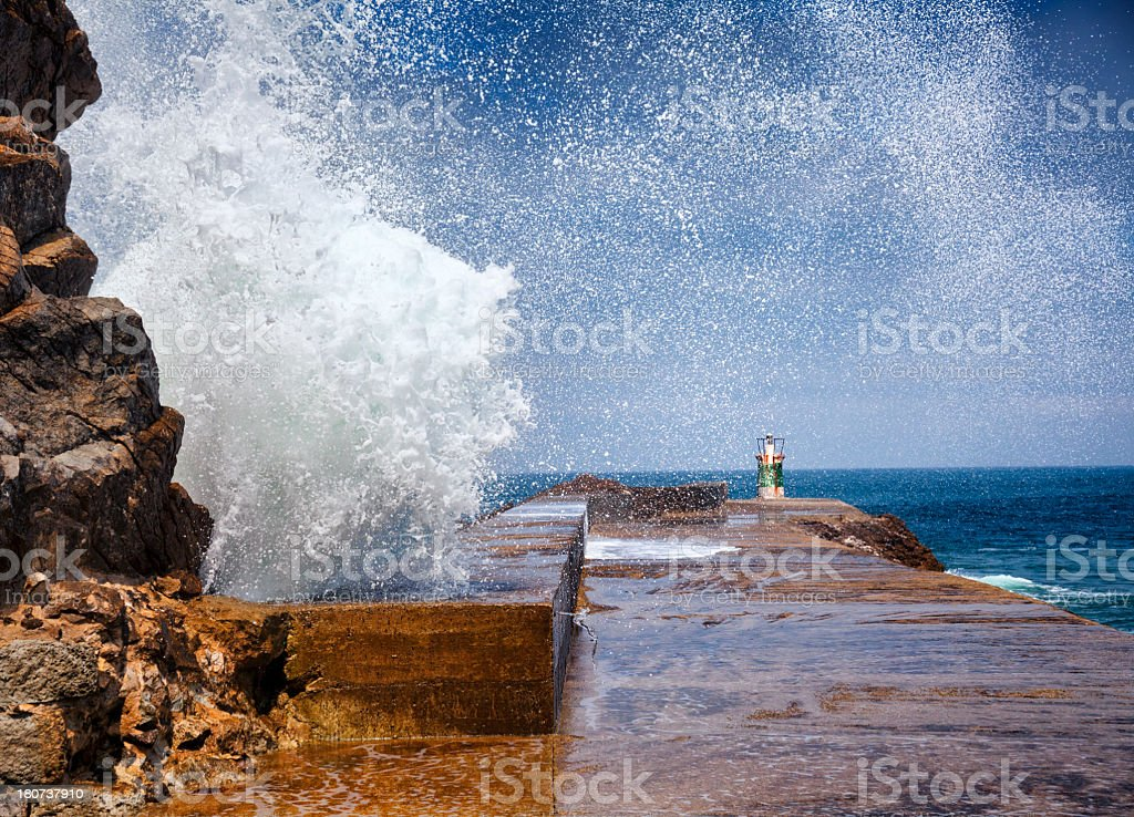 Waves crashing over lighthouse , Costa Verde, Spain royalty-free stock photo
