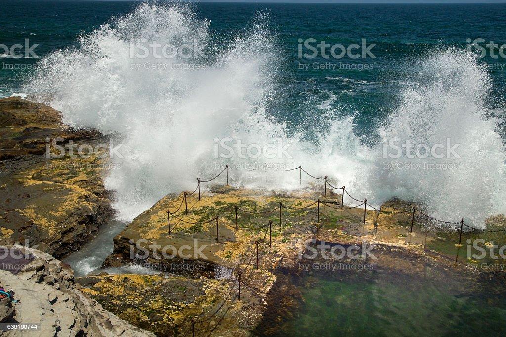 Waves crashing over the railing to the Bogie Hole stock photo
