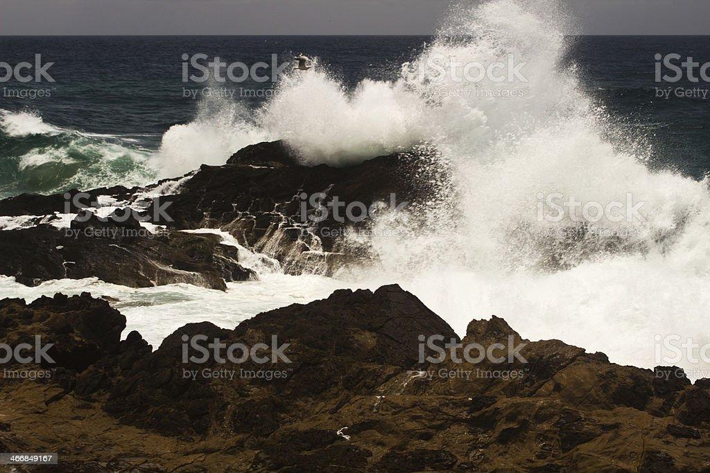 Waves crashng at Cape Byron stock photo