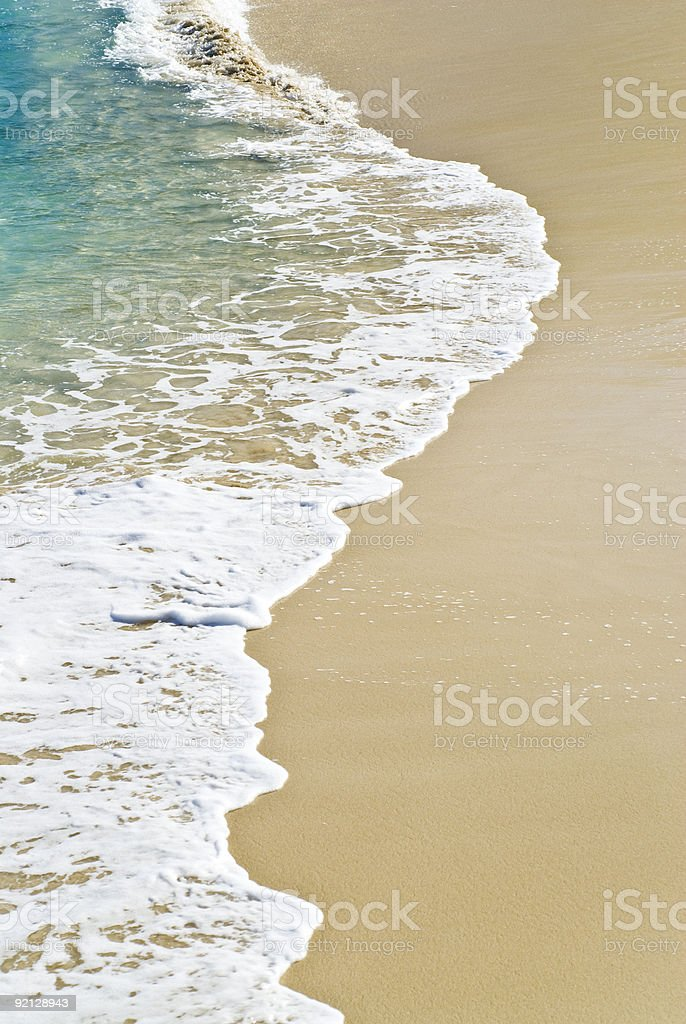 Waves creeping up on the beach royalty-free stock photo
