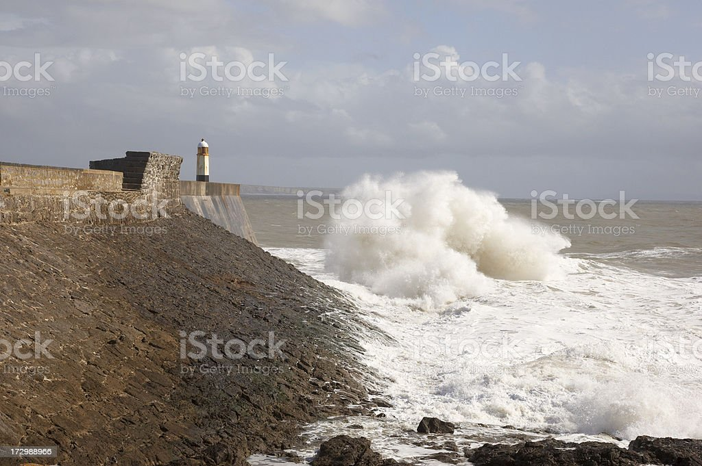 Waves foaming at the lighthouse royalty-free stock photo