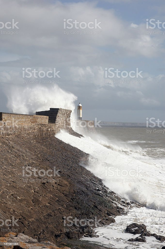 Waves foaming near the lighthouse royalty-free stock photo