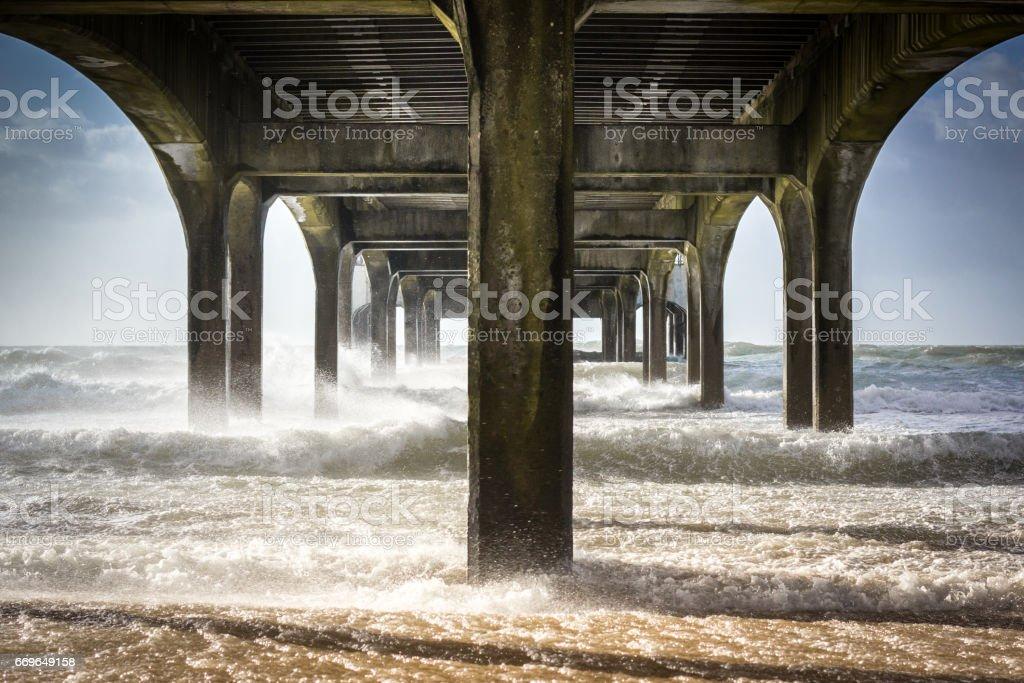 Waves from Storm Doris crash into Boscombe Pier stock photo