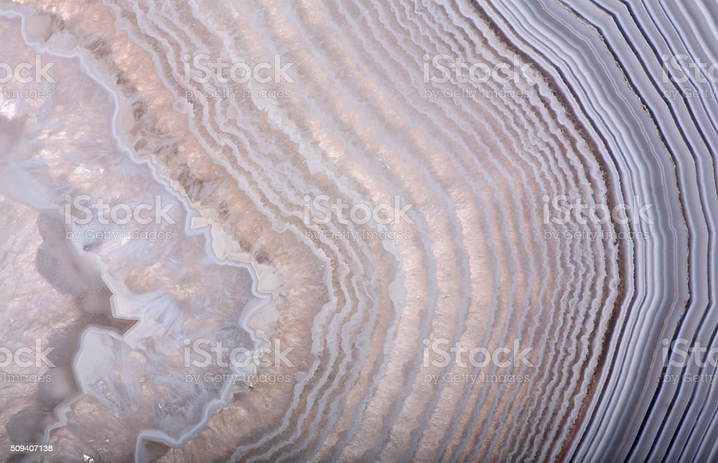 waves in light agate structure stock photo