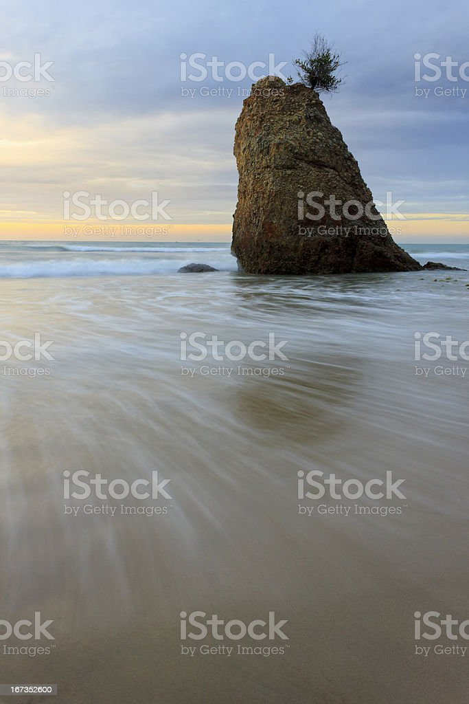 Waves in motion at sunset royalty-free stock photo