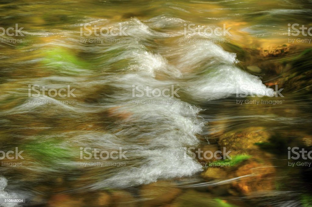 Waves in the river stock photo