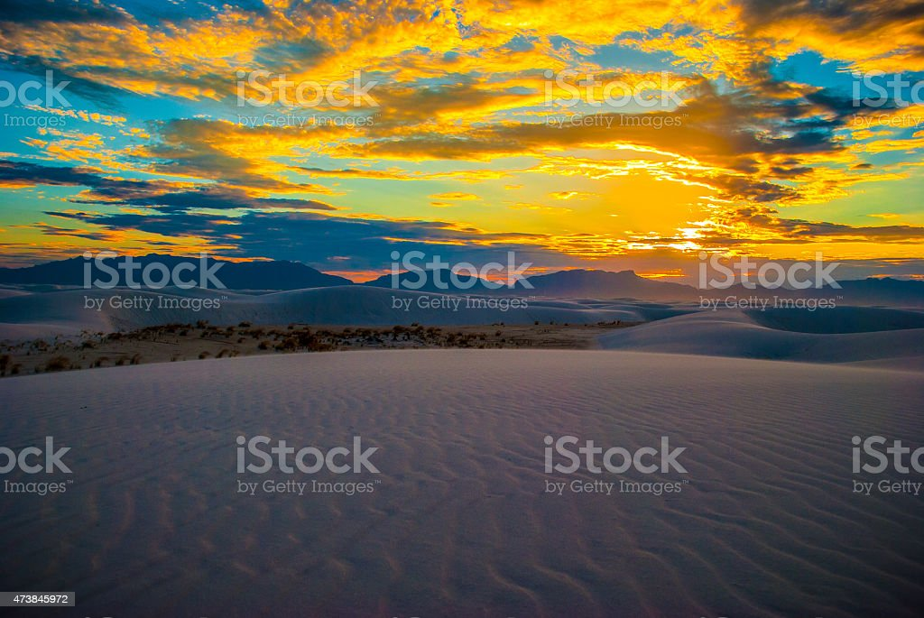 Waves in White Sand Dune Park New Mexico windy sunset stock photo
