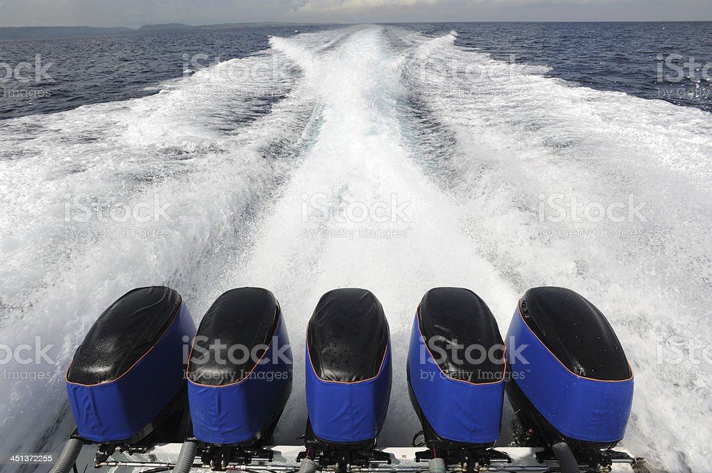 Waves of a outboard motor boat royalty-free stock photo