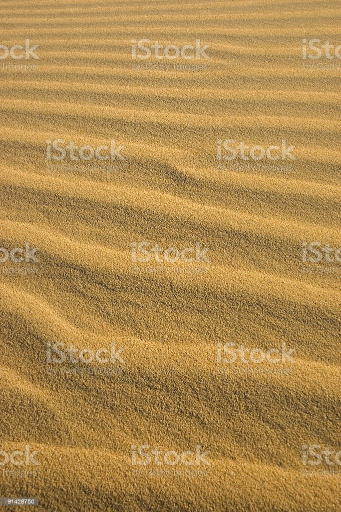 Waves of sand in the desert stock photo