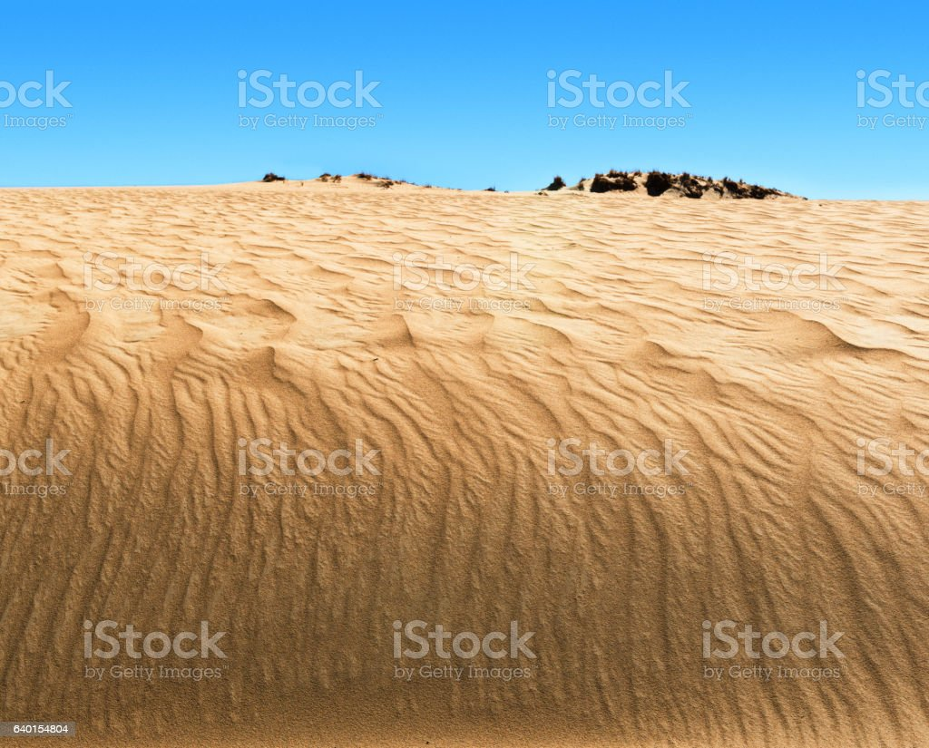 Waves of sand in valley of  Brahmaputra in Tibet. stock photo
