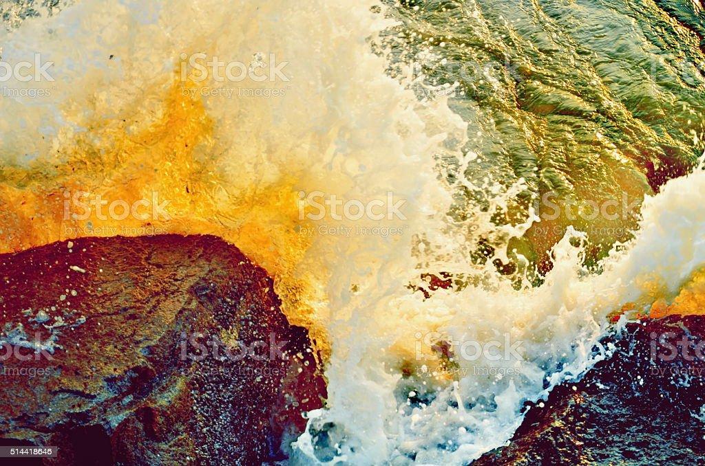 waves of sea on rocky coast stock photo