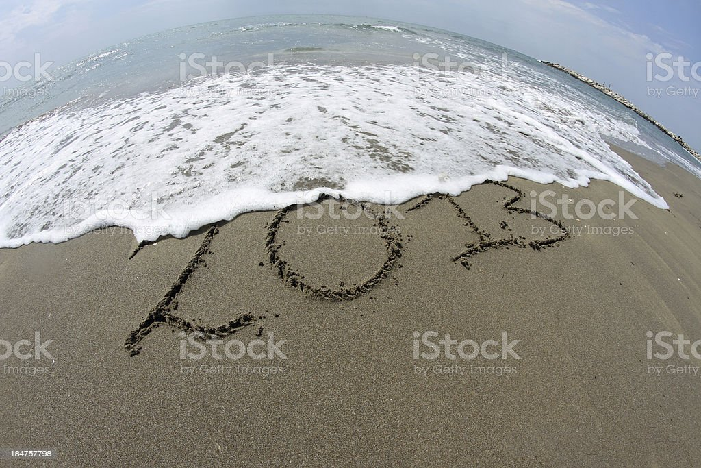 waves of the sea on beach that erase year 2013 royalty-free stock photo