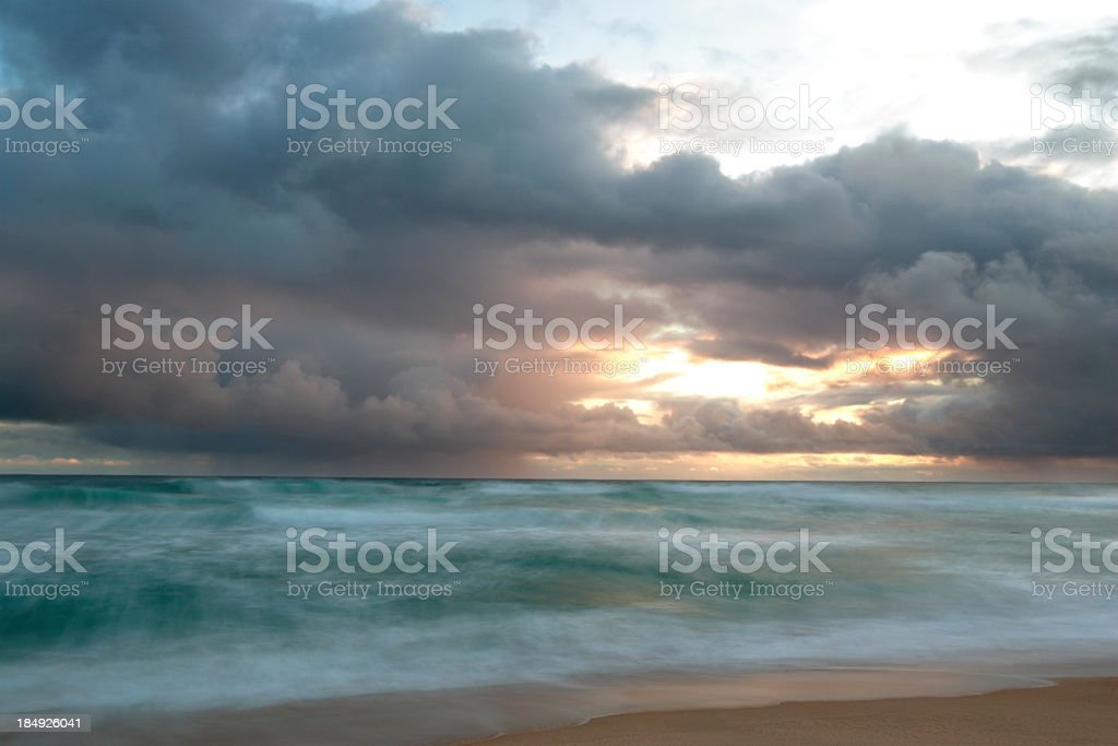 Waves on a Beach at Sunset stock photo