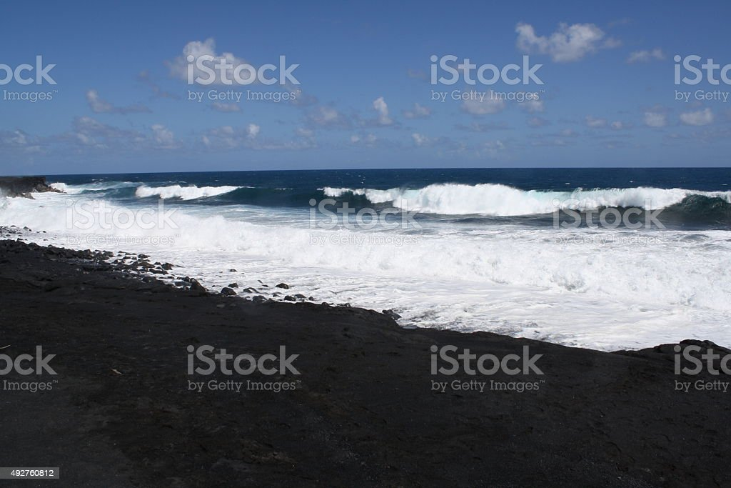 Waves on black sand beach royalty-free stock photo