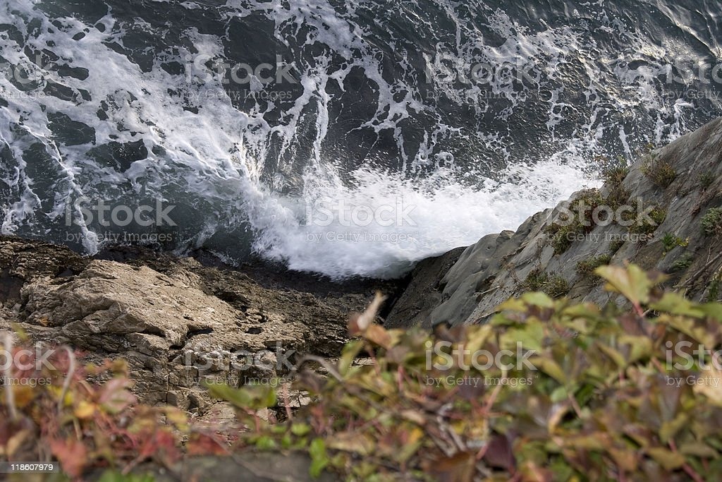 Waves on Cliff stock photo