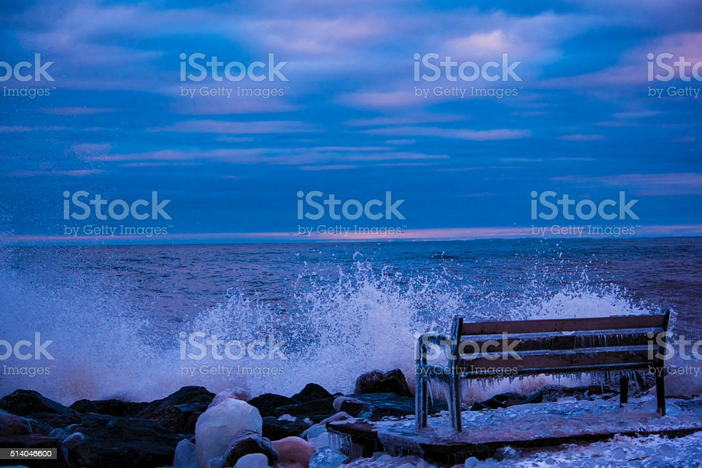 Waves on frozen Park Bench royalty-free stock photo