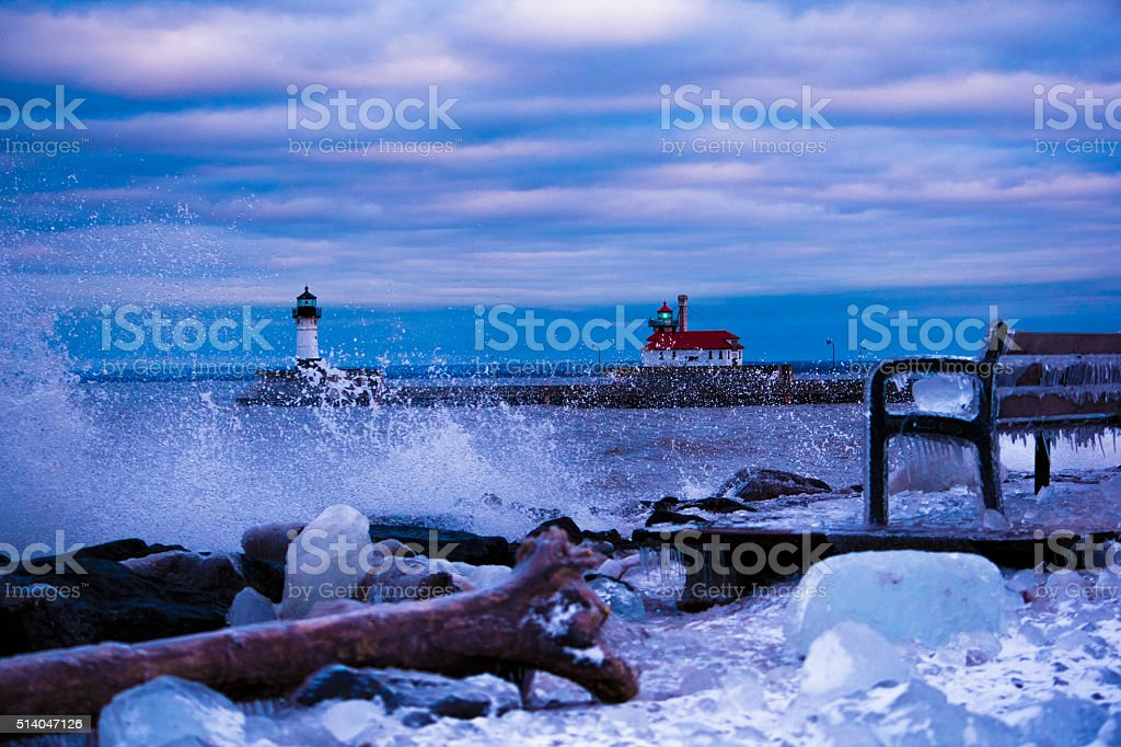 Waves on Lake Superior by lighthouse stock photo