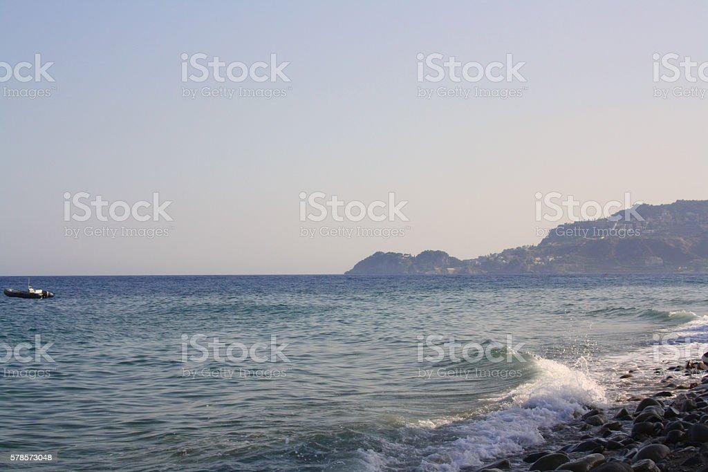 waves on rocky coast and blue sea stock photo