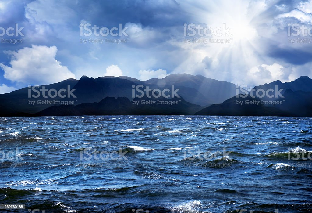 waves on sea over stormy clouds stock photo