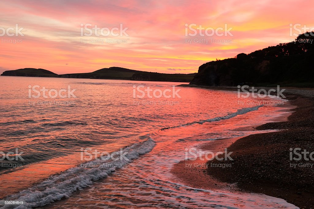 waves on the beach of russian isle Putyatin stock photo