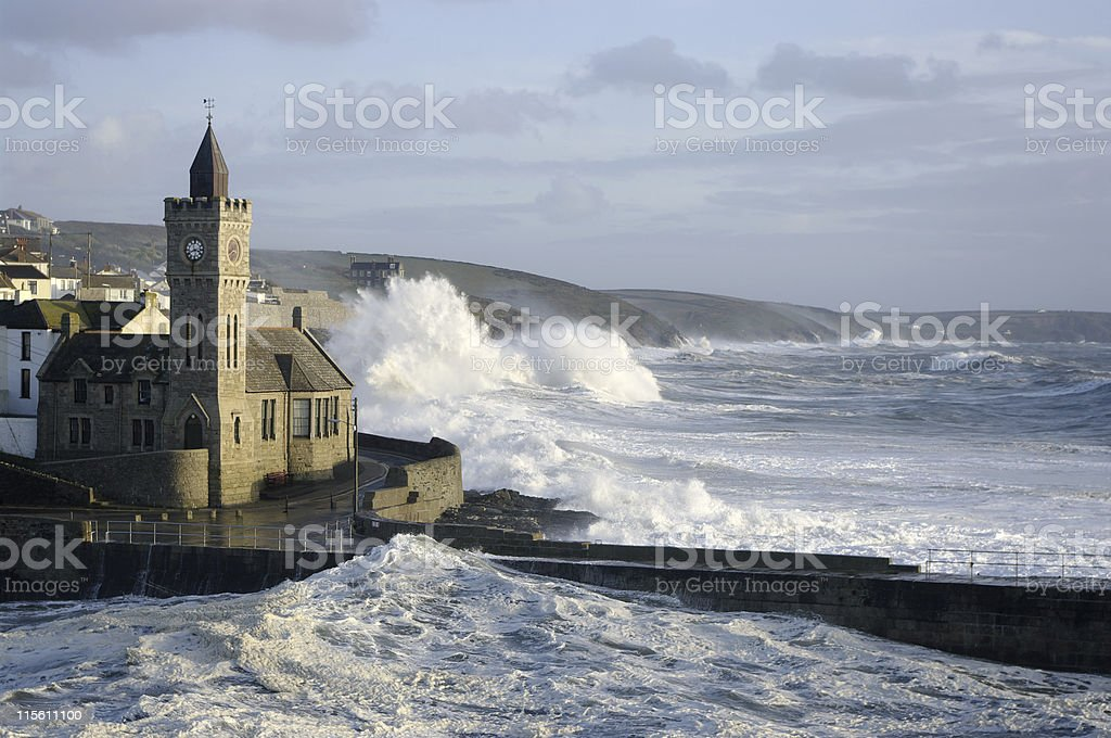Waves over the rocks during a storm at Porthleven, Cornwall stock photo