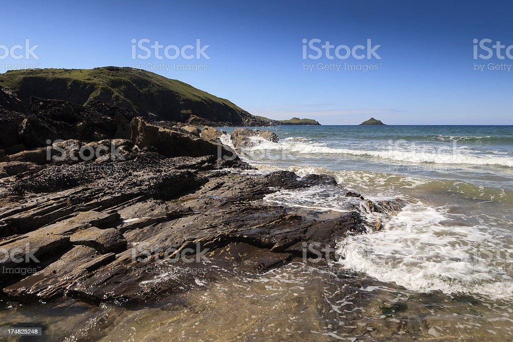waves reaching the shore at Lundy Bay in Cornwall royalty-free stock photo