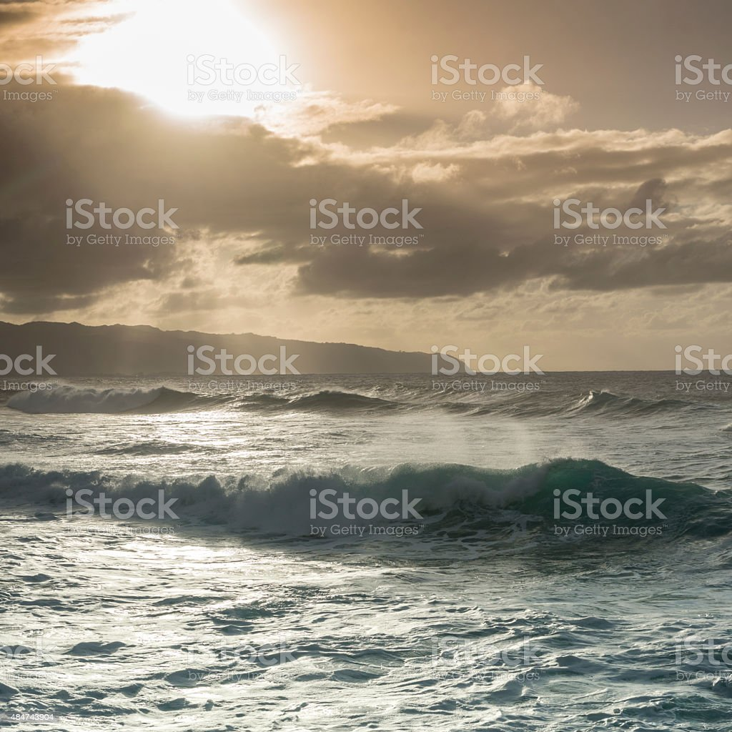 Waves roll across sea after storm stock photo