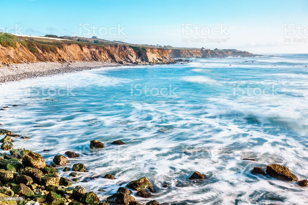 Waves Rolling Gently onto the Rocky Beach stock photo