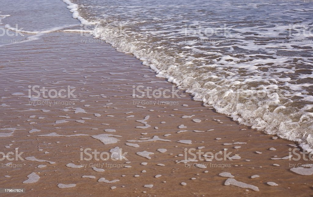 Waves Rolling In as Sea Washes Out royalty-free stock photo