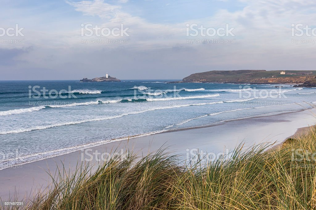 Waves rolling into Godrevy beach on the coast of Cornwall stock photo