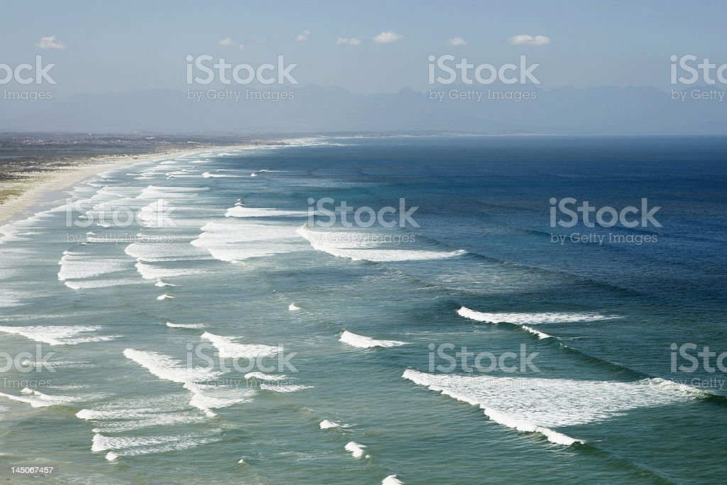 Waves rolling on sandy beach stock photo