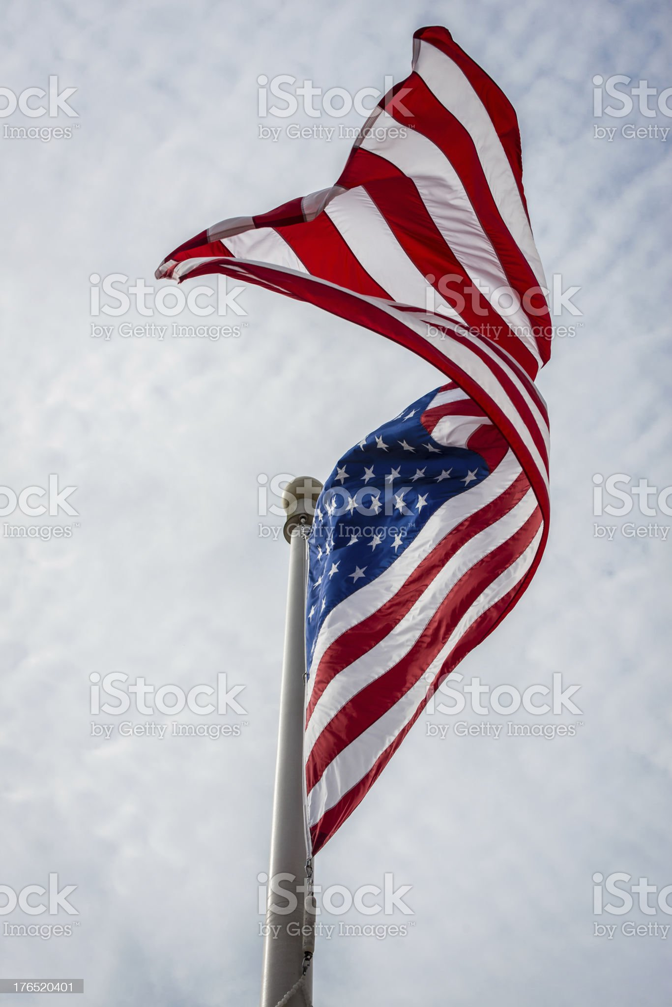 Waving American Flag on a Pole with Cloudscape Background royalty-free stock photo