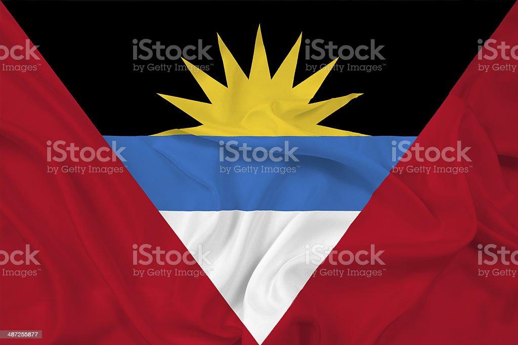 Waving Antigua and Barbuda Flag stock photo