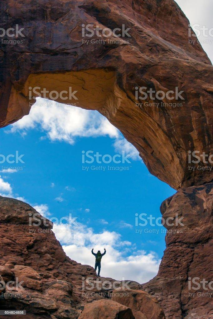 Waving arch hiker stock photo