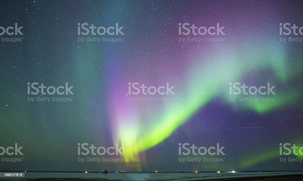 Waving aurora borealis in rural landscape stock photo