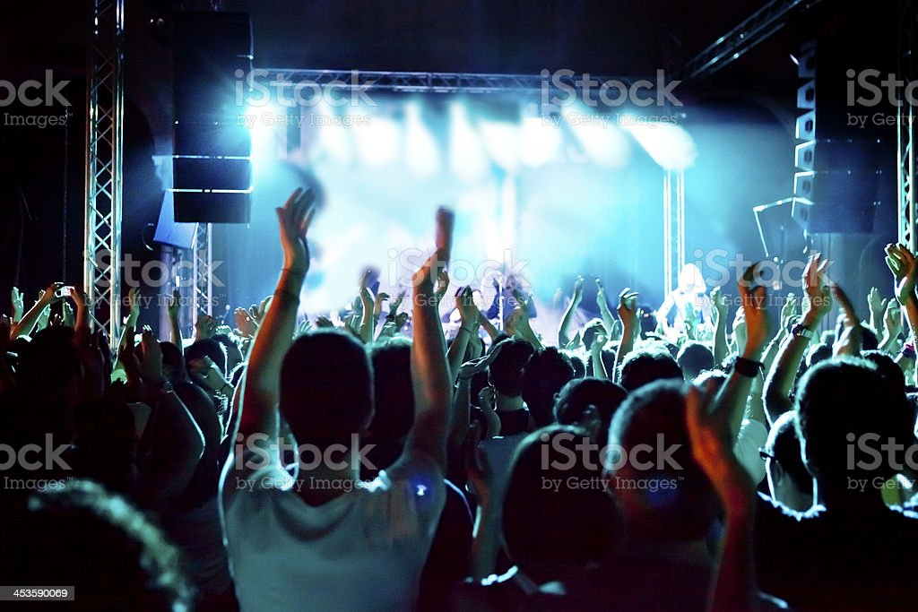 Waving during the concert stock photo