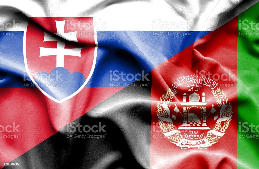 Waving flag of Afghanistan and Slovak stock photo