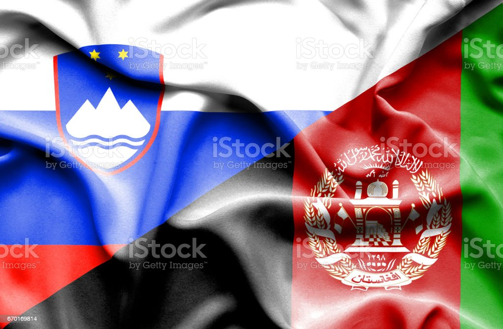 Waving flag of Afghanistan and Slovenia stock photo
