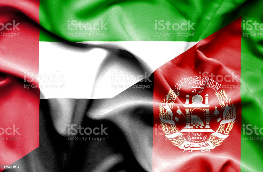 Waving flag of Afghanistan and United Arab Emirates stock photo