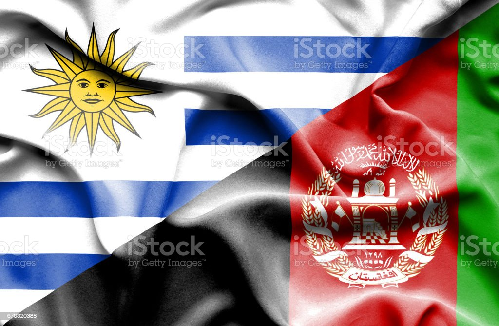 Waving flag of Afghanistan and Uruguay stock photo