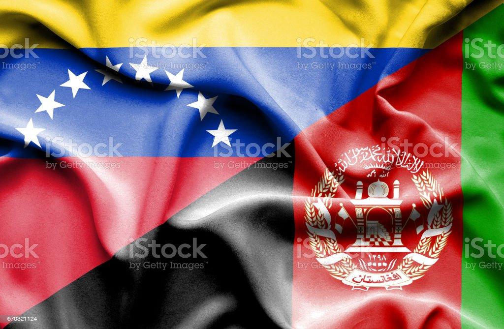 Waving flag of Afghanistan and Venezuela stock photo