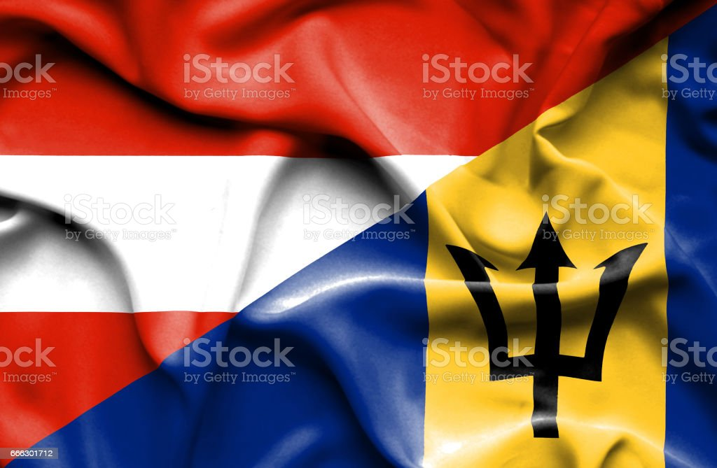 Waving flag of Barbados and Austria stock photo