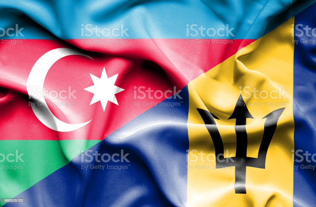 Waving flag of Barbados and Azerbaijan stock photo