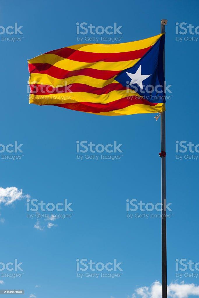 Waving flag of Catalonia stock photo