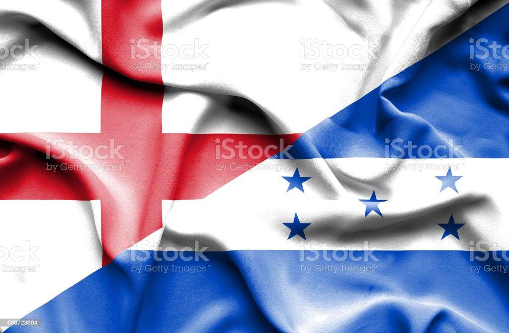 Waving flag of Honduras and England stock photo