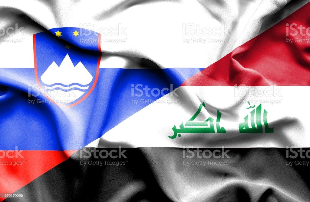 Waving flag of Iraq and Slovenia stock photo
