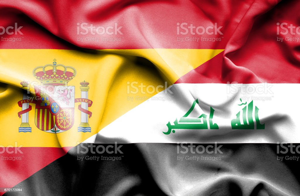 Waving flag of Iraq and Spain stock photo