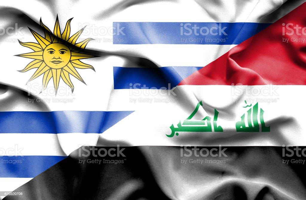 Waving flag of Iraq and Uruguay stock photo